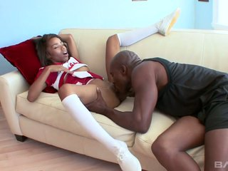Ebony cheerleader Lauren Lesley has a quickie thither twosome hot blooded disastrous cohort